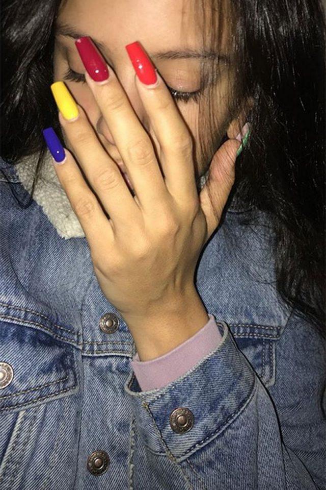Labios de Vuitton, dientes de oro y cejas teñidas de rojo: 20 veces que Rosalía sorprendió al mundo